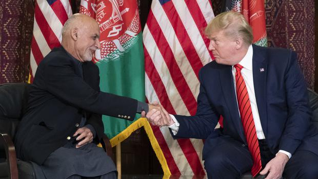 President Donald Trump shakes hands during a meeting with Afghan President Ashraf Ghani (Alex Brandon/AP)