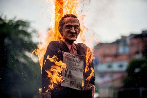 "A dummy of US President Barack Obama reading ""Obama abolish the decree now"" is burnt as the ""Burning of Judas"", during an Easter celebration, at El Valle shantytown in Caracas on April 5, 2015. Dolls of US President Barack Obama and his Venezuelan counterpart Nicolas Maduro were burnt in Caracas on Easter Sunday during the traditional ""Burning of Judas"", which had as its backdrop the climate of political tension between Venezuela and the United States. AFP/Getty Images"