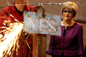 Deputy First Minister Nicola Sturgeon watching apprentice Craig McKee manufacturing a steel 'Yes' sign at Steel Engineering in Renfrew, Scotland ahead of the Scottish independence referendum on Thursday. PRESS ASSOCIATION Photo. Picture date: Tuesday September 16, 2014. See PA story REFERENDUM Main. Photo credit should read: Lynne Cameron/PA Wire