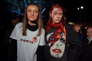 """Crowds gather outside the Ritzy cinema in south London to sing and pay homage to British singer David Bowie following the announcement of Bowie's death on January 11, 2016. British music icon David Bowie died of cancer at the age of 69, drawing an outpouring of tributes for the innovative star famed for groundbreaking hits like """"Ziggy Stardust"""" and his theatrical shape-shifting style.  AFP PHOTO / NIKLAS HALLE'NNIKLAS HALLE'N/AFP/Getty Images"""