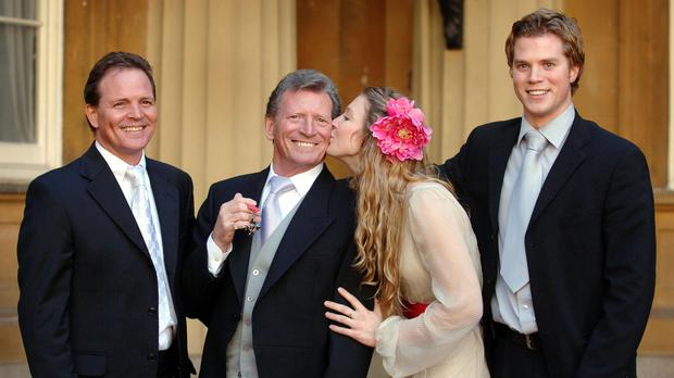 Johnny Briggs with children, left to right, Mark, Stephanie and Michael after being made an MBE (Fiona Hanson/PA)