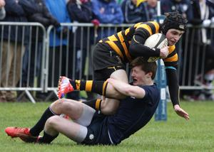 RBAI's Connor Field is tackled by MCB's Connor Kelly