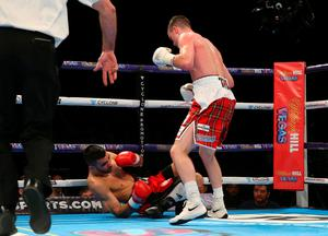 Josh Taylor knocks down and stops Lyes Chaibi during his victory in the Super-Lightweight Contest at Manchester Arena on February 27, 2016 in Manchester, England.  (Photo by Alex Livesey/Getty Images)