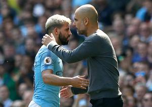 Sergio Aguero is embraced by manager Pep Guardiola (Martin Rickett/PA)