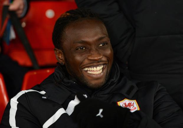 MANCHESTER, ENGLAND - JANUARY 28:  New Cardiff signing Kenwyne Jones looks on prior to the Barclays Premier League match between Manchester United and Cardiff City at Old Trafford on January 28, 2014 in Manchester, England.  (Photo by Michael Regan/Getty Images)