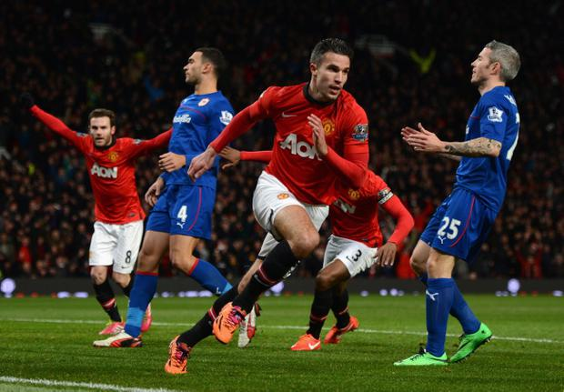 MANCHESTER, ENGLAND - JANUARY 28:  Robin van Persie of Manchester United celebrates scoring the opening goal during the Barclays Premier League match between Manchester United and Cardiff City at Old Trafford on January 28, 2014 in Manchester, England.  (Photo by Michael Regan/Getty Images)