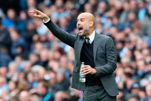 Manchester City manager Pep Guardiola gestures on the touchline during the Premier League match at the Etihad Stadium, Manchester. PA