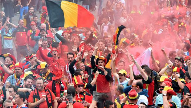 Belgium's supporters cheer their team at the main square, La Grand Place, in Lille on July 1, 2016 ahead of the Euro 2016 football tournament quarter final match between Belgium and Wales. / AFP PHOTO / PHILIPPE HUGUENPHILIPPE HUGUEN/AFP/Getty Images