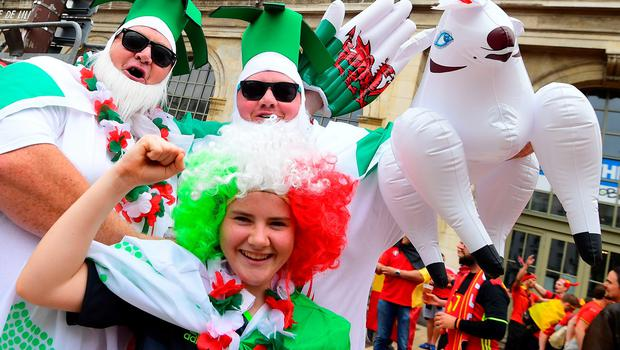 Wales supporters cheer in a street of Lille on July 1, 2016 before the Euro 2016 quarter-final football match between Wales and Belgium. / AFP PHOTO / EMMANUEL DUNANDEMMANUEL DUNAND/AFP/Getty Images