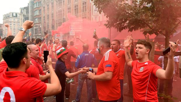 Wales fans in the centre of Lille before the UEFA Euro 2016, quarter final match at the Stade Pierre Mauroy, Lille. PRESS ASSOCIATION Photo. Picture date: Friday July 1 2016. See PA story SOCCER Wales. Photo credit should read: Joe Giddens/PA Wire. RESTRICTIONS: Use subject to restrictions. Editorial use only. Book and magazine sales permitted providing not solely devoted to any one team/player/match. No commercial use. Call +44 (0)1158 447447 for further information.