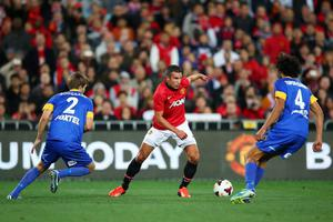 SYDNEY, AUSTRALIA - JULY 20:  Robin Van-Persie of Manchester United controls the ball during the match between the A-League All-Stars and Manchester United at ANZ Stadium on July 20, 2013 in Sydney, Australia.  (Photo by Brendon Thorne/Getty Images)