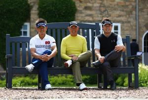 GULLANE, SCOTLAND - JULY 15:  Hiroyuki Fujita of Japan, Toru Taniguchi of Japan and Daisuke Maruyama of Japan sit in front of the clubhouse ahead of the 142nd Open Championship at Muirfield on July 15, 2013 in Gullane, Scotland.  (Photo by Matthew Lewis/Getty Images)