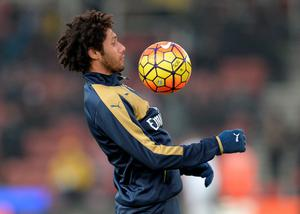 Arsenal's Egyptian midfielder Mohamed Elneny warms up ahead of the English Premier League football match between Stoke City and Arsenal at the Britannia Stadium in Stoke-on-Trent, central England on January 17, 2016.