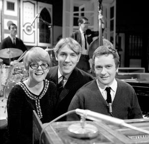 Comic duo Dudley Moore (right) and Peter Cook are joined in a sketch by singer Cilla Black in 1966. PA Wire.
