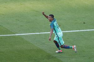 Portugal's Nani celebrates scoring his side's first goal during the Euro 2016 Group F soccer match between Hungary and Portugal at the Grand Stade in Decines-Charpieu, near Lyon, France, Wednesday, June 22, 2016. (AP Photo/Michael Sohn)