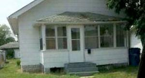 This image via the Hammond Police Department appears to show a figure at the window on the right side of the porch. Source: Hammond Police Department