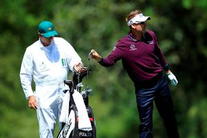 AUGUSTA, GEORGIA - APRIL 07:  Ian Poulter of England pulls a club from his bag as caddie Terry Mundy looks on, on the fifth hole during the first round of the 2016 Masters Tournament at Augusta National Golf Club on April 7, 2016 in Augusta, Georgia.  (Photo by David Cannon/Getty Images)