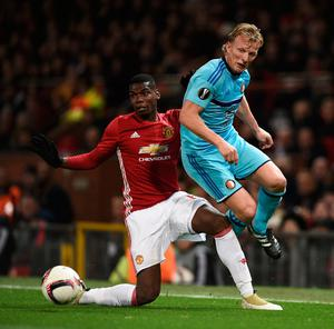 Manchester United's French midfielder Paul Pogba (L) holds off Feyenoord's Dutch striker Dirk Kuyt (R) during the UEFA Europa League group A football match between Manchester United and Feyenoord at Old Trafford stadium in Manchester, north-west England, on November 24, 2016. / AFP PHOTO / Oli SCARFFOLI SCARFF/AFP/Getty Images