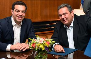 This handout picture received from the Greek Ministry of Defence shows Greek Prime Minister Alexis Tsipras (L) meeting with leader of the Independent Greeks party and Defence Minister, Panos Kamenos, at the Defence Ministry in Athens on July 2, 2015. Greece's radical left government suggested it would resign if it fails to get its way in a make-or-break referendum July 5 that could decide the country's financial future. AFP PHOTO / POOL / Greek Ministry of DefenceHO/AFP/Getty Images
