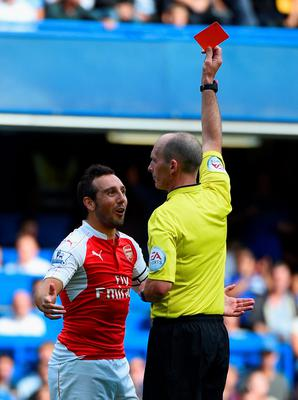 LONDON, ENGLAND - SEPTEMBER 19:  Santi Cazorla of Arsenal is shown a red card by referee Mike Dean during the Barclays Premier League match between Chelsea and Arsenal at Stamford Bridge on September 19, 2015 in London, United Kingdom.  (Photo by Ross Kinnaird/Getty Images)
