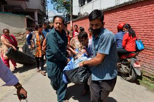 Nepalese patients are carried out of a hospital building as a 7.4 magnitude earthquake hits the country, in Kathmandu on May 12, 2015.   A 7.4-magnitude earthquake hit devastated Nepal, sending terrified residents running into the streets in the capital Kathmandu, according to witnesses and the US Geological Survey.  The quake struck at 12:35pm local time in the Himalayan nation some 83 kilometres (52 miles) east of Kathmandu, more than two weeks after a 7.8-magnitude quake which killed more than 8,000 people.   AFP PHOTO / PRAKASH MATHEMAPRAKASH MATHEMA/AFP/Getty Images
