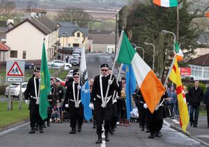Northern Ireland- 23rd February 2014 Mandatory Credit - Photo-Jonathan Porter/Presseye.  30th anniversary parade for IRA members Henry Hogan and Declan Martin in Dunloy who were shot dead by the British Army in the Co. Antrim village in 1984.  The parade makes its way through the village.