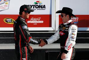 DAYTONA BEACH, FL - FEBRUARY 16: (R-L) Austin Dillon, driver of the #3 DOW Chevrolet, speaks with Martin Truex Jr., driver of the #78 Furniture Row Chevrolet, after qualifying for the NASCAR Sprint Cup Series Daytona 500 at Daytona International Speedway on February 16, 2014 in Daytona Beach, Florida. Austin Dillon qualified for pole position and Martin Truex Jr. qualified second.  (Photo by Tom Pennington/Getty Images)