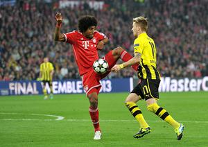 Bayern Munich's Bonfim Dante (left) fouls Borussia Dortmund's Marco Reus (right) resulting in a penalty for Borussia Dortmund during the UEFA Champions League Final at Wembley Stadium, London.
