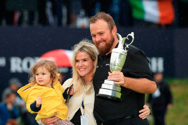 Open Champion Shane Lowry celebrates with the Claret Jug, wife Wendy and daughter Iris.