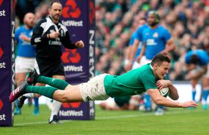Ireland's Jacob Stockdale scores his side's seventh try during the NatWest 6 Nations match at the Aviva Stadium, Dublin. Brian Lawless/PA Wire.