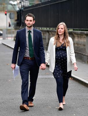 Daniel McArthur, managing director of Ashers Baking Co, and his wife Amy McArthur outside Belfast High Court