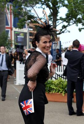 A racegoer smiles as she leaves at the end of day three of the Royal Ascot meeting at Ascot Racecourse, Berkshire. PRESS ASSOCIATION Photo. Picture date: Thursday June 20, 2013. See PA story RACING Ascot. Photo credit should read: John Walton/PA Wire