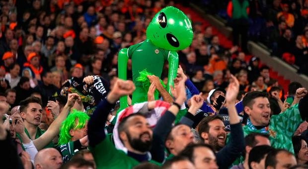 Northern Ireland fans hold up an inflatable alien during the UEFA Euro 2020 qualifying, group C match at the Stadion Feijenoord, Rotterdam. PA Photo. Picture date: Thursday October 10, 2019. See PA story SOCCER Netherlands. Photo credit should read: John Walton/PA Wire. RESTRICTIONS: Editorial use only, No commercial use without prior permission.