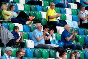 Ballymena United fans in the stands during the Sadler's Peaky Blinders Irish Cup Final match at Windsor Park, Belfast. PA Photo. Picture date: Friday July 31, 2020. Friday's Irish Cup final between Ballymena United and Glentoran is the first football match in the UK to be played in front of spectators since March. Photo credit should read: Liam McBurney/PA Wire