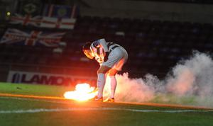 PACEMAKER BELFAST   11/3/2013 Linfield v Shamrock Rovers  Setanta Cup 1/4 final Flares are thrown onto the pitch at  this evenings game at Windsor park in Belfast. Photo Colm Lenaghan/Pacemaker Press