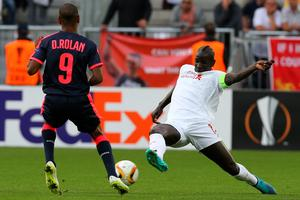 BORDEAUX, FRANCE - SEPTEMBER 17: Mamadou Sakho for Liverpool FC tackle for the ball during the Europa League game between FC Girondins de Bordeaux and Liverpool FC at Matmut Atlantique Stadium  on September 17, 2015 in Bordeaux, France.  (Photo by Romain Perrocheau/Getty Images)