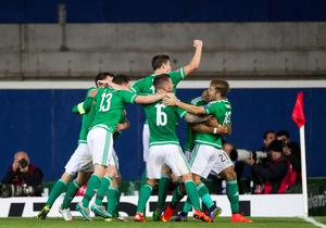 Northern Ireland team celebrate Steven Davis' first goal of the game during the UEFA European Championship Qualifying match at Windsor Park, Belfast. PRESS ASSOCIATION Photo. Picture date: Thursday October 8, 2015. See PA story SOCCER N Ireland. Photo credit should read: Liam McBurney/PA Wire.