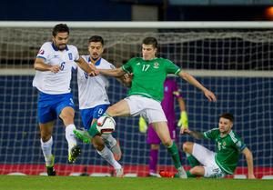 Greece's Alexandros Tziolis (left) and Panagiotis Kone (centre) battle for the ball with Northern Ireland's Paddy McNair during the UEFA European Championship Qualifying match at Windsor Park, Belfast. PRESS ASSOCIATION Photo. Picture date: Thursday October 8, 2015. See PA story SOCCER N Ireland. Photo credit should read: Liam McBurney/PA Wire.