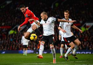 MANCHESTER, ENGLAND - FEBRUARY 09:   Robin van Persie of Manchester United competes with John Heitinga of Fulham during the Barclays Premier League match between Manchester United and Fulham at Old Trafford on February 9, 2014 in Manchester, England.  (Photo by Michael Regan/Getty Images)