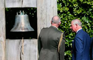 The Prince of Wales views the Peace bell in the grounds of Aras an Uachtarain in Dublin, during their visit to the Republic of Ireland. PRESS ASSOCIATION Photo. Picture date: Wednesday May 10, 2017. See PA story ROYAL Ireland. Photo credit should read: Brian Lawless/PA Wire