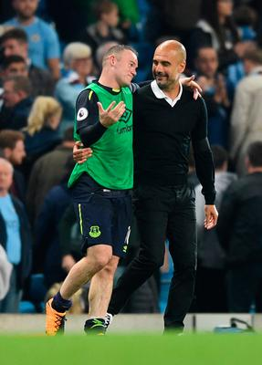 MANCHESTER, ENGLAND - AUGUST 21:  Josep Guardiola, Manager of Manchester City speaks with Wayne Rooney of Everton following the Premier League match between Manchester City and Everton at Etihad Stadium on August 21, 2017 in Manchester, England.  (Photo by Michael Regan/Getty Images)