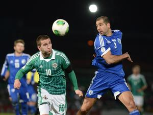 Martin Patterson and Tal Ben Haim during Tuesday's 2014 World Cup qualifier match between Northern Ireland and Israel at Windsor Park, Belfast