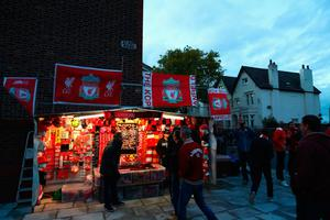 LIVERPOOL, ENGLAND - OCTOBER 17:  Vendors sell merchandise outside the stadium before the Premier League match between Liverpool and Manchester United at Anfield on October 17, 2016 in Liverpool, England.  (Photo by Clive Brunskill/Getty Images)