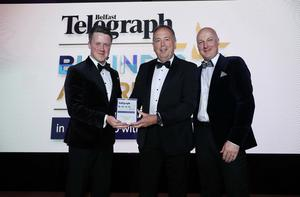 Press Eye - Belfast - Northern Ireland - 2nd May 2019 -   The Belfast Telegraph Business Awards in association with Ulster Bank at the Crowne Plaza Hotel, Belfast.   Retailer of the Year Award Sponsored by Retail NI William and Chris Suitor from Suitor Brothers Tailoring Presented by Retail NI President, Peter McBride  Photo by Kelvin Boyes / Press Eye.