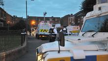 Police flood Comber Court in the Mountpottinger area of Belfast after a man was shot dead last night