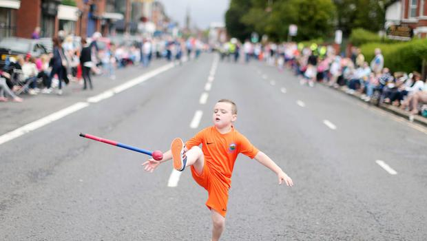 Press Eye - Belfast -  Northern Ireland - 13th July  2015  Belfast's Orange Order annual 12th of July demonstration makes its way through the City Centre to the field at Malone House beside Shaws Bridge.  Seven-year-old Conor Boyd waits for the parade on the Lisburn Road.   Picture by Jonathan Porter/Press Eye