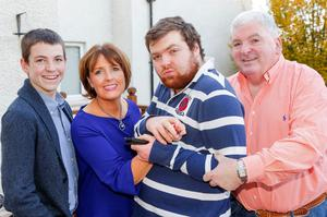 Feargal with his wife Anne and sons Ruairi (left) and Seamus, who has severe autism