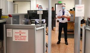 Security Staff wear PPE at Belfast International Airport which reopens on Monday June 15th. PA Photo. Picture date: Thursday June 11, 2020. See PA story HEATH Coronavirus Ulster . Photo credit should read: Niall Carson/PA Wire