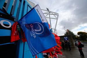 A Leinster flag amongst tributes to former Ireland and Munster star Anthony Foley outside Thomond Park in Limerick, after the 42-year-old head coach was found dead in the province's team hotel in Paris on Sunday, hours before the team were due to take to the pitch in the European Champions Cup. PRESS ASSOCIATION Photo. Picture date: Monday October 17, 2016. See PA story DEATH Foley. Photo credit should read: Niall Carson/PA Wire
