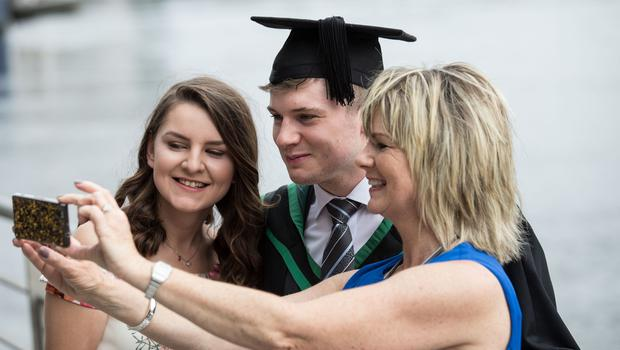 Richard Knox from Lisburn graduates with BSc Hons in Computing Science. He is pictured here with girlfriend Robyn McGeown and mum Deborah Kingham. (Photo: Nigel McDowell/Ulster University)